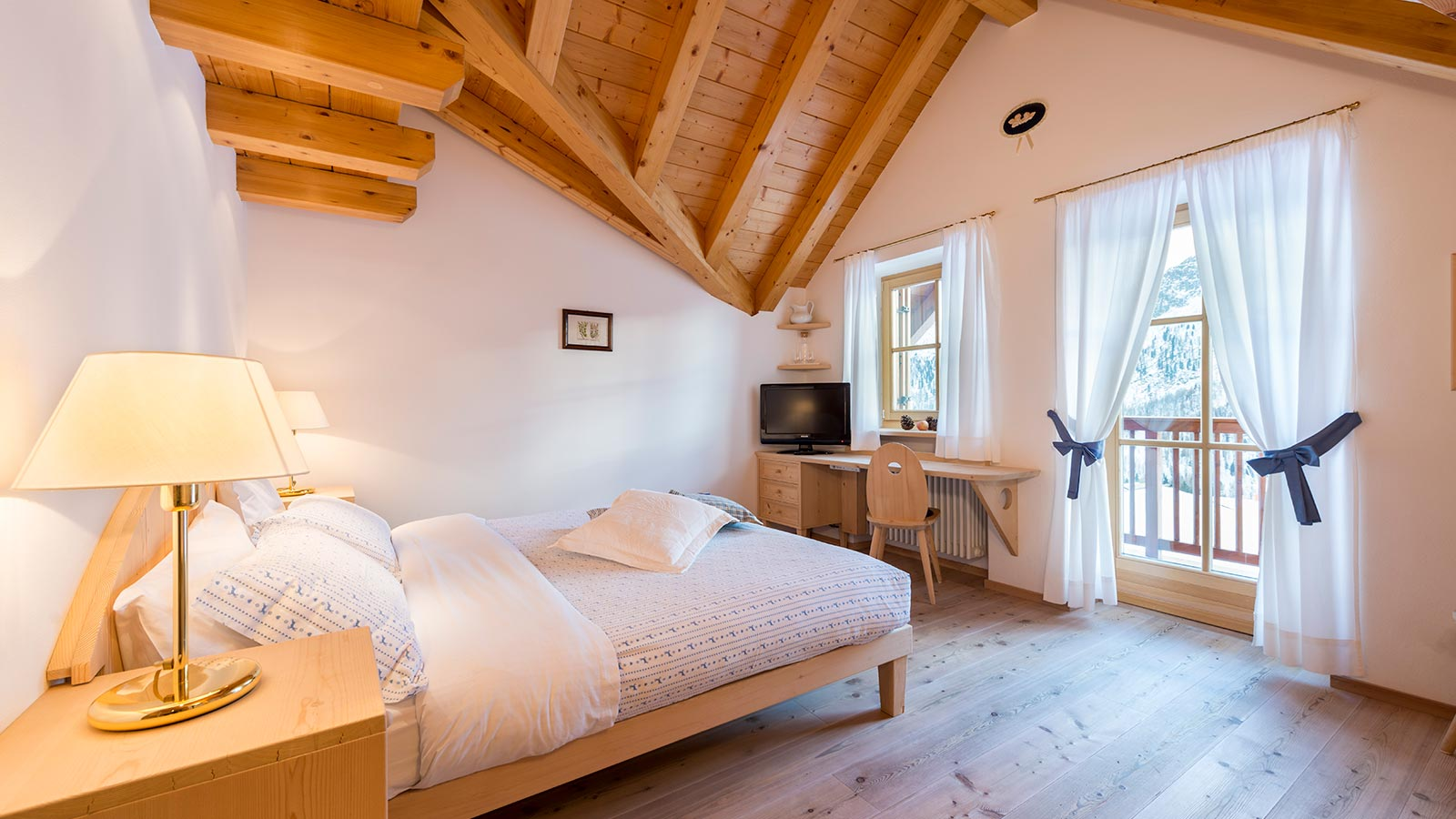 Particular of a bedroom of the Chalet at San Pellegrino Pass