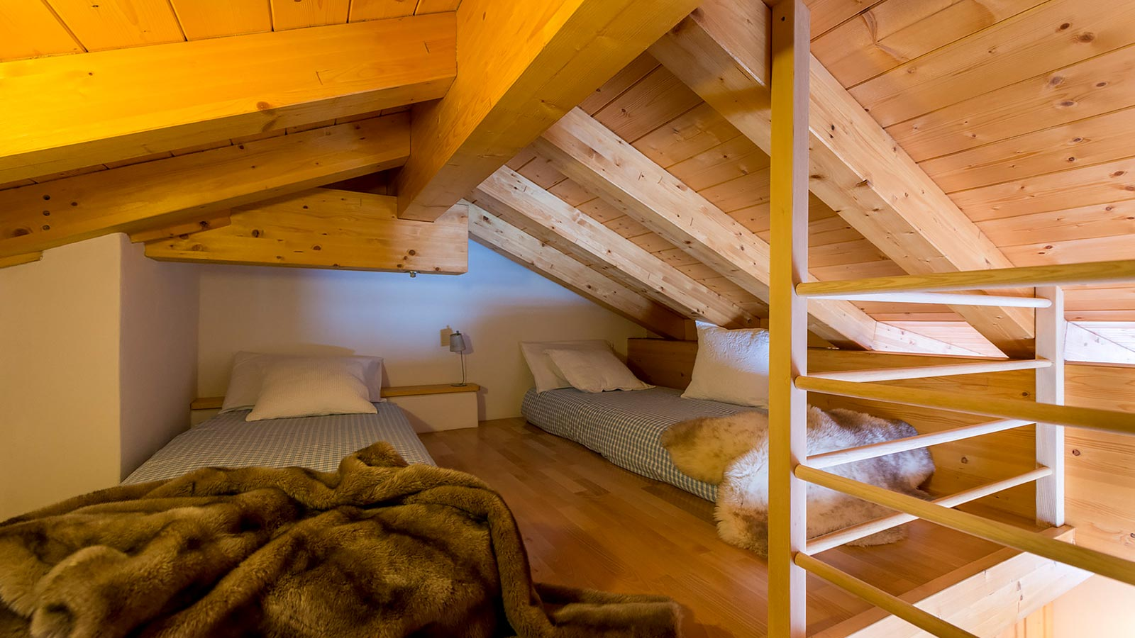 Detail of two single beds in the attic of a room