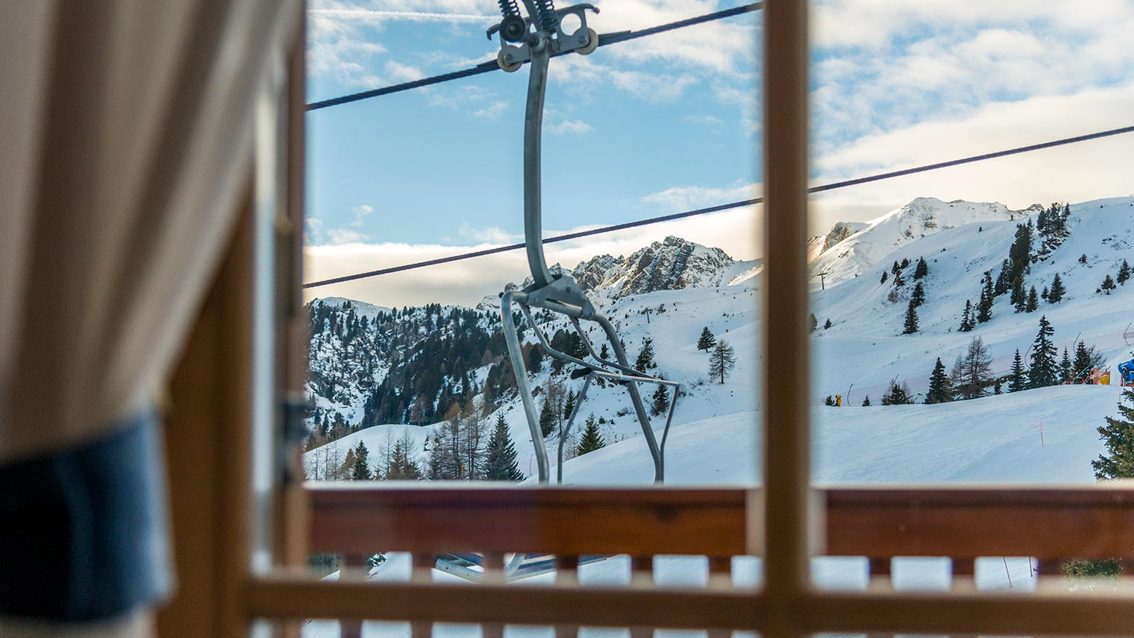 A view of the ski resort at San Pellegrino Pass through one of the windows